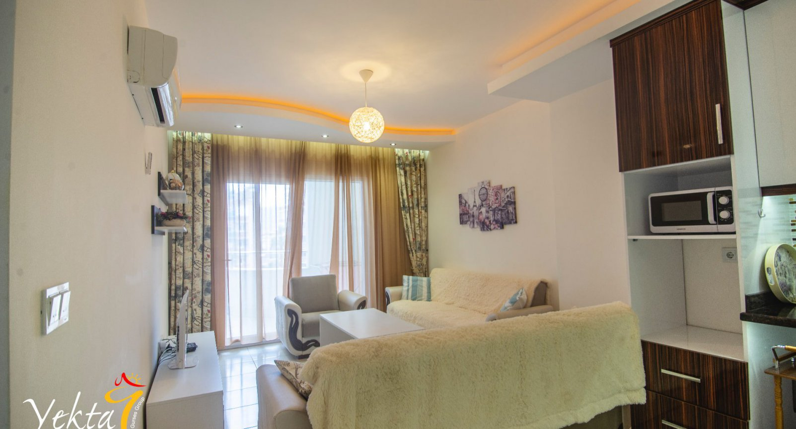 Комфортабельные апартаменты 1+1 в Махмутларе