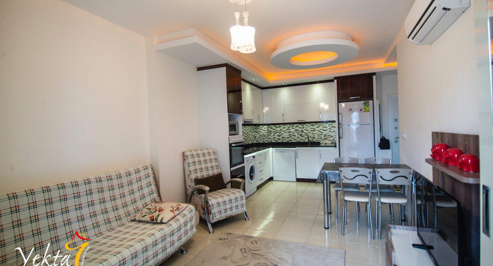 Прекрасные апартаменты 1+1 в уютном тихом районе Махмутлар