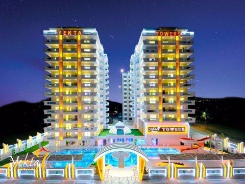 Фотография вида спереди Yekta Towers Residence с подсветкой