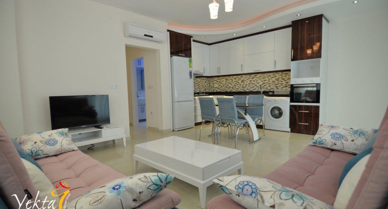 Новые апартаменты 2+1 в центре развитого района Махмутлар