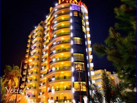 Фотография Yekta Queen Residence с ночной подсветкой