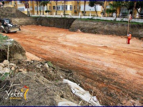 Фотография подготовки земли для заливки фундамента