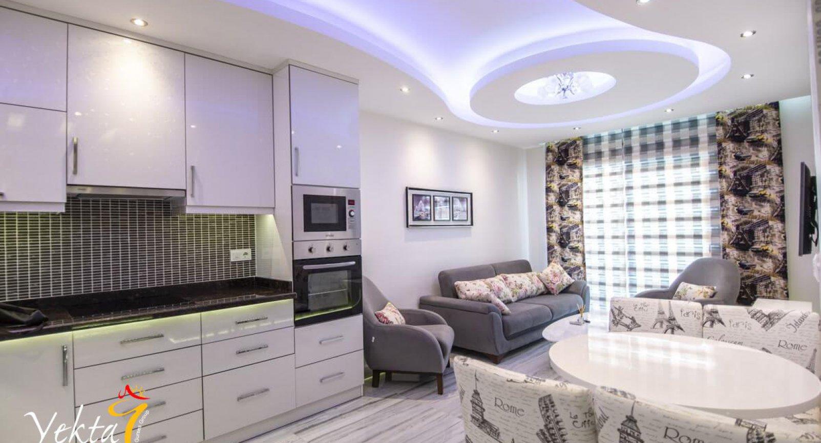 Современные апартаменты 1+1 с прекрасным видом в Махмутларе